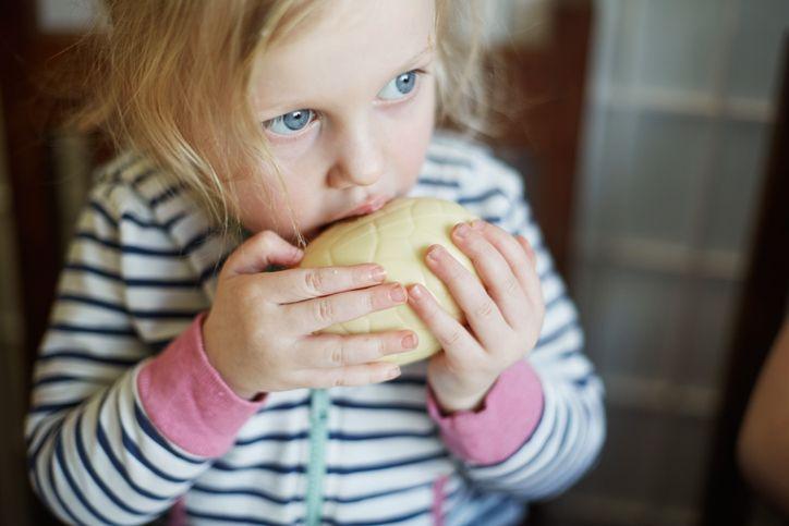 girl biting into an easter egg