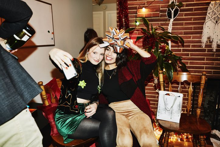 two girls at a holiday party