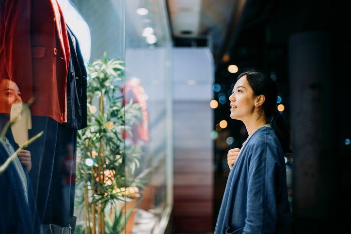 woman looking at a clothing display