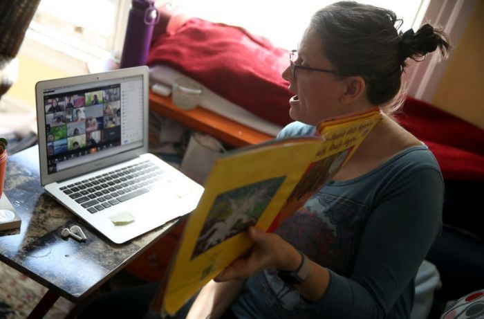 Leanne Francis, first grade teacher at Harvey Milk Civil Rights Academy, conducts an online class from her living room