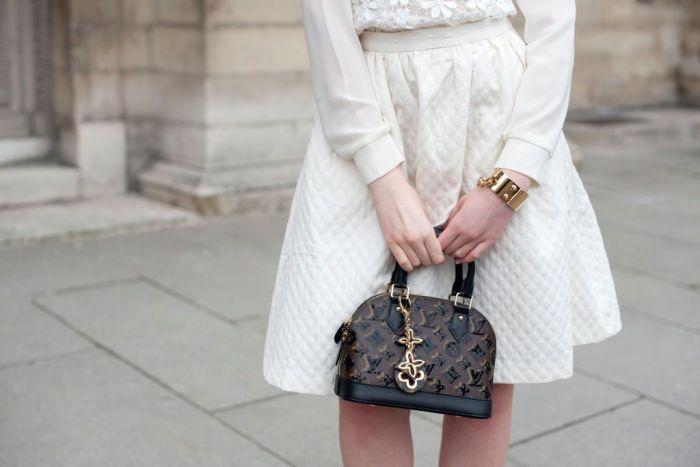 A woman holding a Louis Vuitton bag