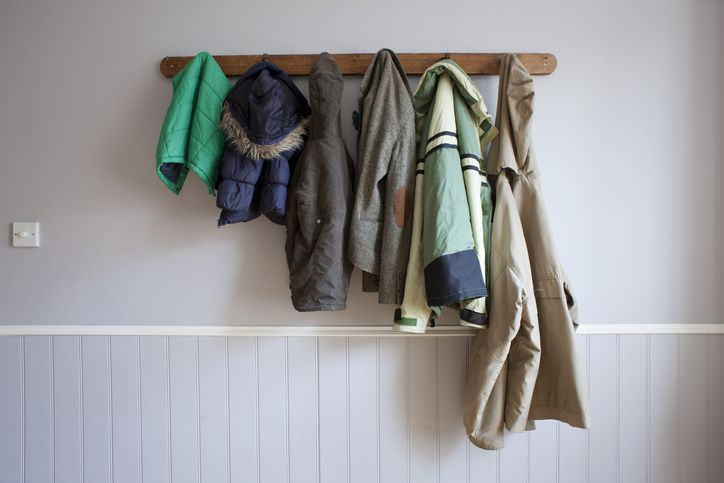 coats hanging on a rack