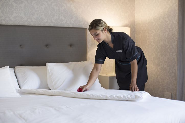 chambermaid cleaning a room