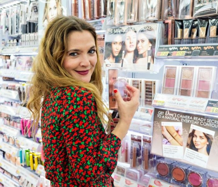 Drew Barrymore stopped by a Bentonville, AR Walmart on June 15, 2017 to check out her exclusive line of FLOWER products