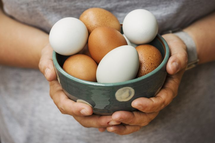 woman holding a bowl of eggs