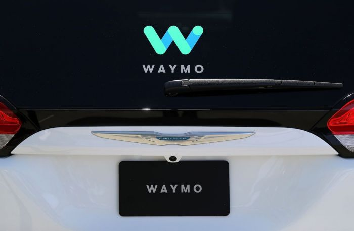 The Waymo logo is displayed on a self-driving vehicle at the Google I/O 2018 Conference at Shoreline Amphitheater on May 8, 2018 in Mountain View, California