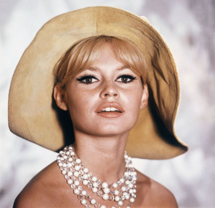Portrait of Brigitte Bardot during a presentation of a collection of hats, 1966, Paris, Franc