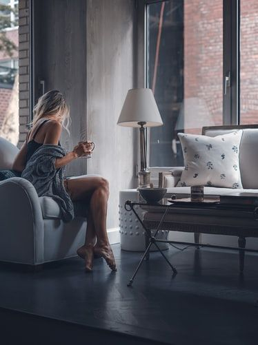 Woman in lounge clothes sitting in a luxurious apartment building in Manhattan