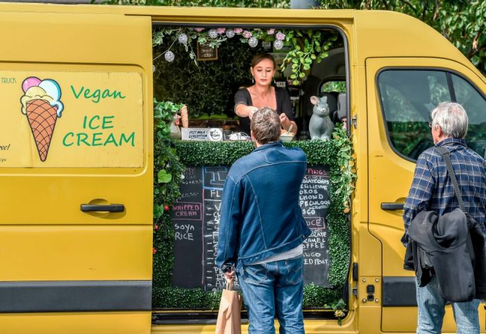 People queue to buy vegan food at a food truck during the Calais Vegan Festival organised by the French association Farplace, on September 8, 2018