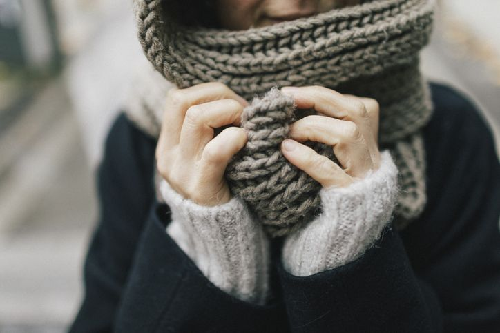 woman wearing knitted scarf