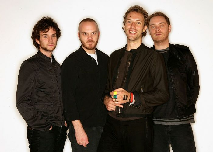 Guy Berryman, Will Champion, Chris Martin and Jonny Buckland of Coldplay, nominated for the award for Best Album, pose for a portrait in the backstage studio at the 12th annual MTV Europe Music Awards 2005