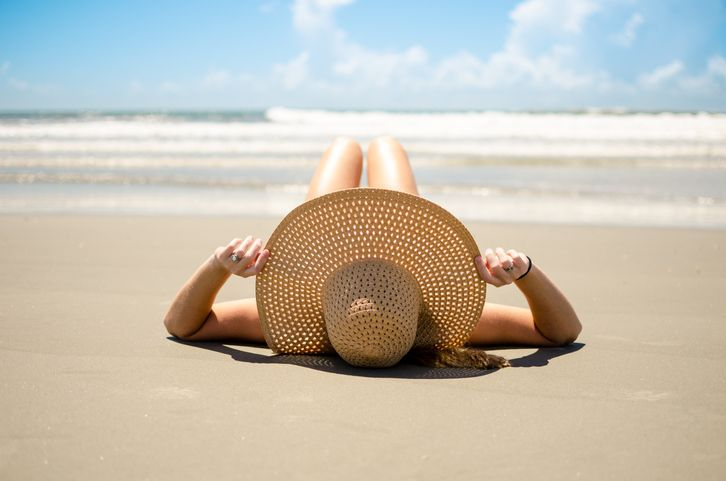 woman in a straw hat on the beach