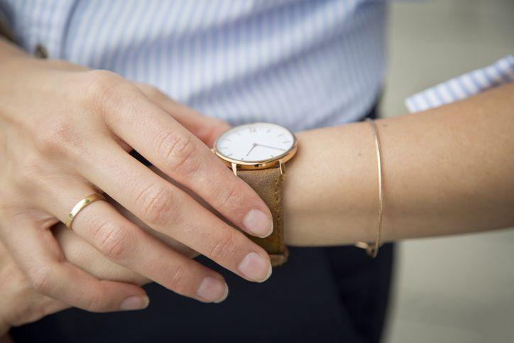 woman touching her watch
