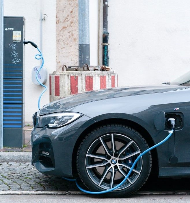 BMW electric hybrid vehicle at a charging station