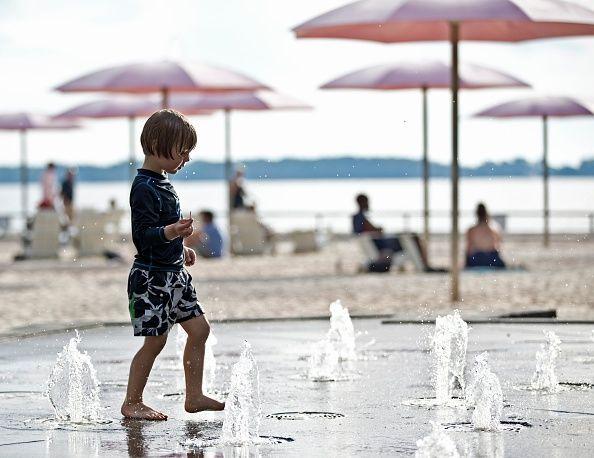 pink umbrellas beach