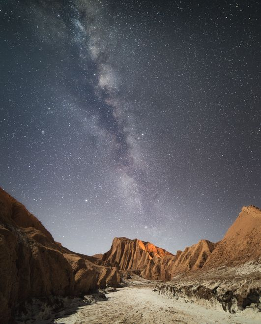 Scenic view of Mountains against star field in the Atacama Desert, Chile