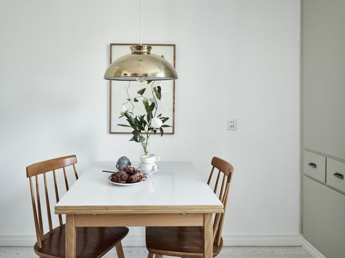 Dining table with croissants on top