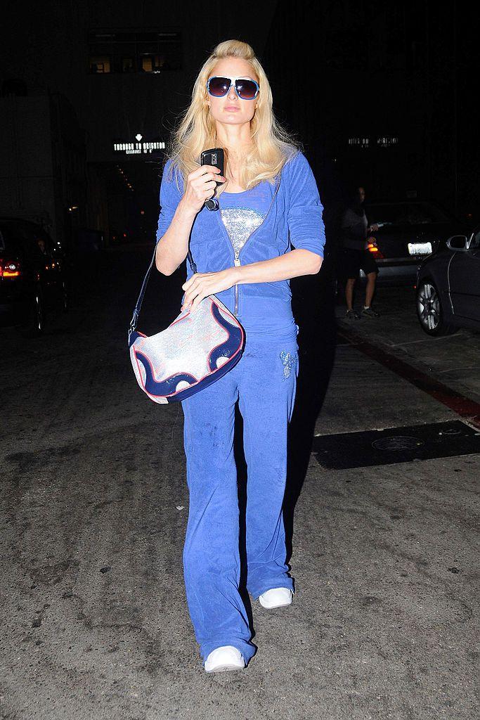 Paris Hilton wearing a blue Juicy Couture tracksuit