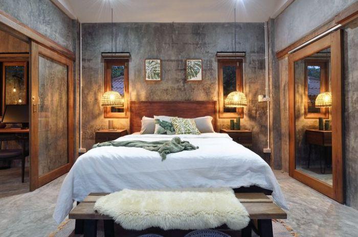 Stylish tropical bedroom at night