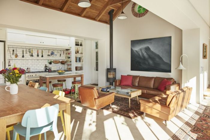 Furniture arranged in living room with painting on wall