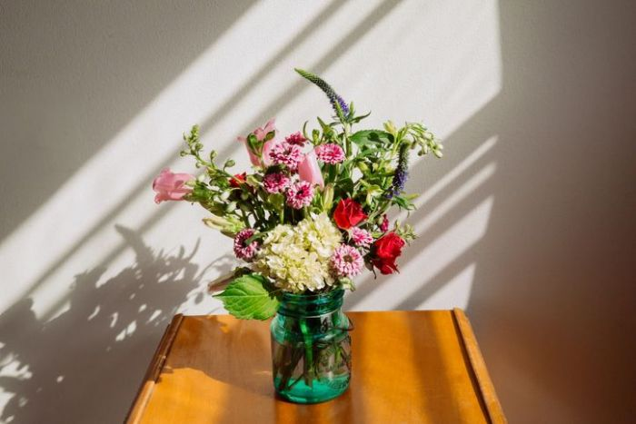 Flower arrangement on top of a wooden table
