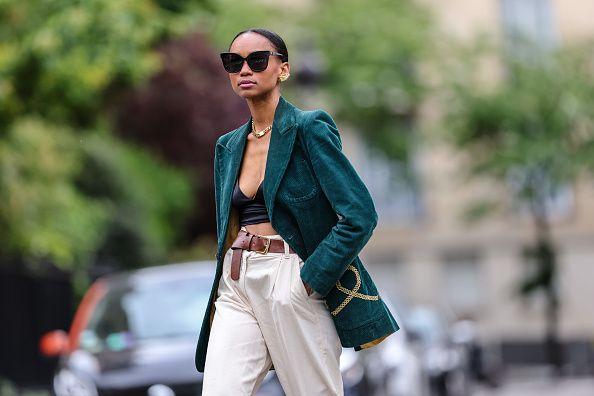 Woman wearing emerald green blazer